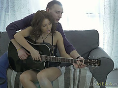 Cute legal age teenager Erin enjoys playing guitar and engulfing rod previous to steamy sex