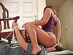 Tied to chair and facesat by sexy dark brown