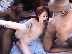 Slender redhead wench with diminutive bazookas receives nailed by 2 hung darksome boys