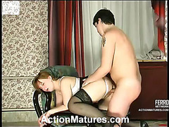 Luscious aged babe getting down to hard twat-pounding on the armchair