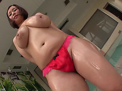 Breasty oriental beauty oiled up and groped