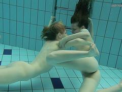 2 lusty brunette hair bints undress every other below the water