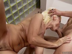 BLOND KATE BLOND GIVES GIVING BLOWJOB FUN TO HER EXCITED GANGBANG BUDDY