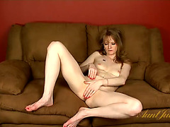 Exposed mama rubs her fingers all over her clit