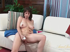 Lubed and lustful mamma with a large marital-device