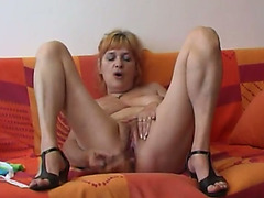 Kinky older floozy bonks herself with her glass sex toy
