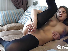 Blond masturbating with her fingers on daybed