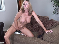 Golden-Haired bitch fingers her gash on the ottoman