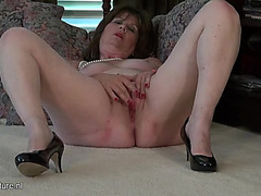 Pearls and heels on a stripped masturbating aged honey