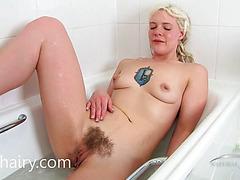 Sexy blond taking a bathroom