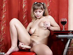 Lewd sweetheart toys her unshaved twat