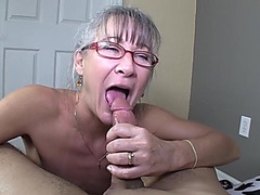 Nice-Looking hawt granny is engulfing a wonderful pecker