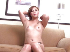 Inked tgirl tugging her weenie solo