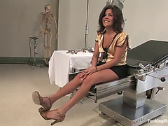 Sexy brunette hair squirts all over the place fucking a machine