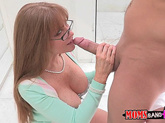 Darla crane maintains eyecontact during the time that blowing his pecker