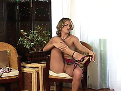 Breathtaking blond solo model masturbating with a toy