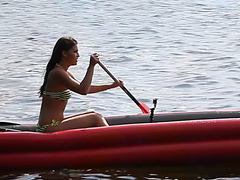 Zena little plays with her snatch and piddles in the midst of lake on a boat