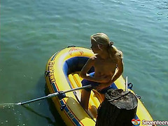 Tiny legal age teenager masturbates outdoors in an inflatable boat