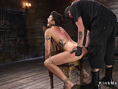 Large butt dark brown in chair spanked