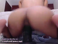 Latin Babe riding biggest sextoy with anus showing