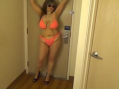 Tinja shows dangerous curves in an orange string bikini