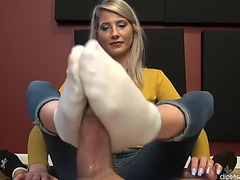 Blond hottie gives sockjob,threatening footjob