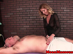 Aged masseuse dominating with toy during hj