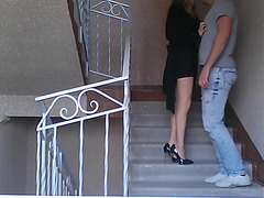 Hot ballbusting on stairs