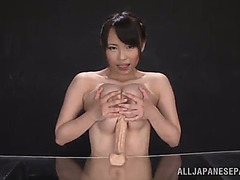 Breasty jap playgirl gives 10-Pounder shaped vibrator a titjob