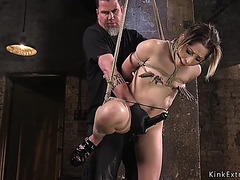 Hogtied hottie drilled with pecker on a stick