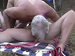 Older pair fuck in woods
