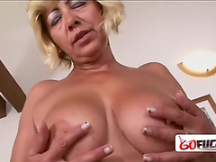 Lewd golden-haired granny receives a large darksome knob for the 1st time ever