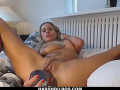Appealing blond bombshell dildoing herself