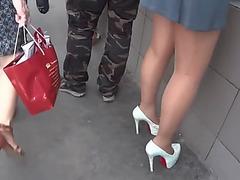 Upskirt in short costume,threatening nylons and high heels