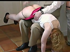 A male spanks 2 females