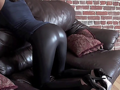 Spanked in shiny leggings