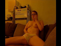 Sexy nerdy hotty masturbates with her pants on