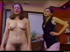 Beauty spanked by mature lesbo