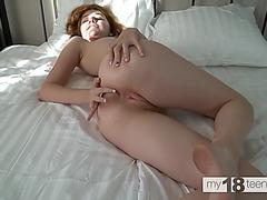 Redhead sofa tease