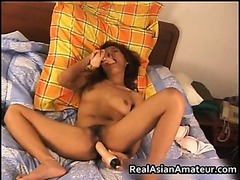 Asian cutie spreads her cunt 10