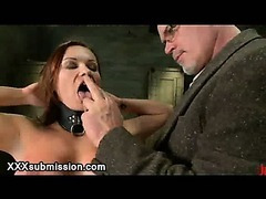 Two guys flogging busty babe and fuck her throat