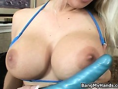 Blonde with big tits pleasing her pussy