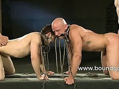 Slaves serving Spencer and Van in tall boots