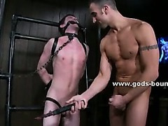 Pervert master locked in leather outfit spanking ass with whip and tormenting bound sex slave
