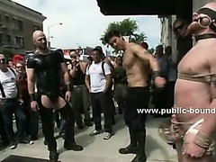 Experienced gay hunk in leather takes slave in ropes and starts the gangbang sex romp