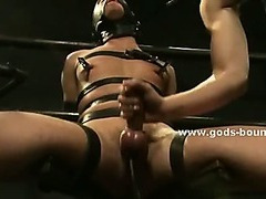 Gay hunk model in leather enjoys his bound man fucking his throat and tight holes in bondage video