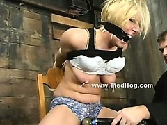 Blonde bitch tied like a hog in underground room where pervert man brings his victims to torment