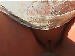 Upskirt showing her shaved pussy