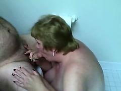 Fat wife sucking his throbbing cock