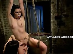 Delicious lesbian mistress in stockings and black dress covering perfect body torments slave